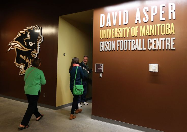 Visitors head into the David Asper University of Manitoba Bison Football Centre at the U of M Kinesiology-Recreation, Bison Sports and Rec Services open-house event at Investors Group Field at the U of M on Sept. 26, 2013. Photo by Jason Halstead