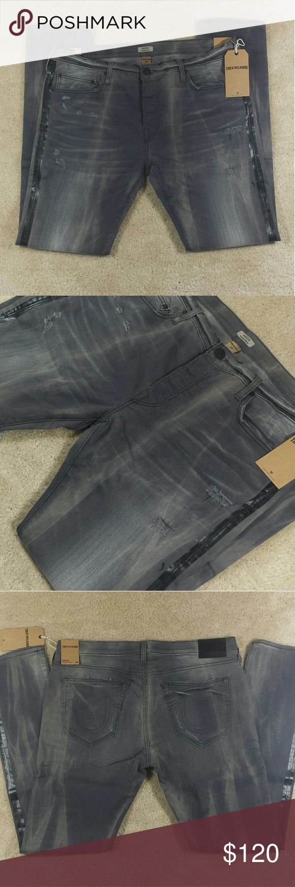 SALE - *NWT* TRUE RELIGION Men's Relaxed Skinny *NWT* TRUE RELIGION Men's Rocco Relaxed Skinny Jeans.  Distressed with black stripe on the side of the leg.  Color: BXJM RCKLS Size: 38 x 34 Fit: Relaxed Skinny Enclosure: Button Fly Retail: $298  Made in the USA True Religion Jeans Skinny