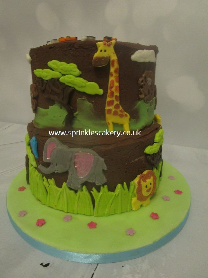 This cake was actually made for a 6 year old girl celebrating her birthday with a visit to a local zoo, but these handmade fondant animals would look super cute on a toddler  birthday cake too.