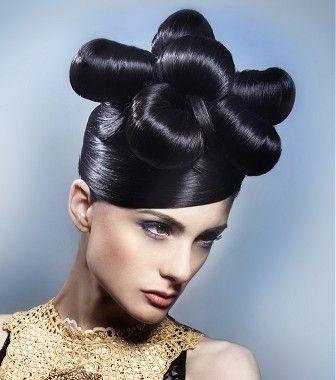 A long black straight sculptured updo avant-garde sleek hairstyle by Mikel Luzea