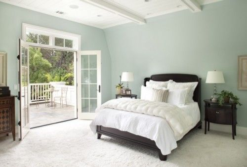 What a kick to stop at a soft, dreamy bedroom with french doors onto a balcony, and realize that this is my bedroom set! Same bed, nightstands and lamps! Oh, and that's the color I want for my accent wall.