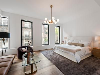 """This second-floor unit has a large outdoor terrace that runs the entire width of the 21.3m-wide building and is """"bigger than any townhouse backyard""""."""