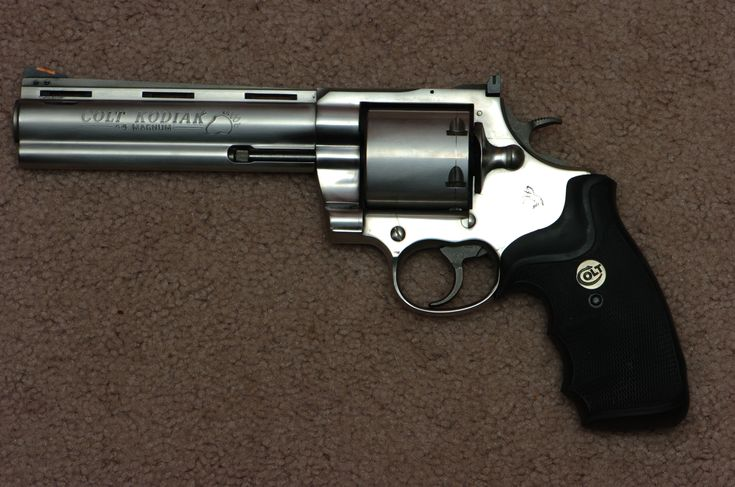 Colt Kodiak .44.  Like the Anaconda, but with ported barrel and un-fluted cylinder.  And you can only say the bear print on the barrel looks gay if you're the one holding it.