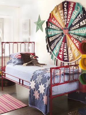 A patriotic vintage quilt is a great addition to a kid's room. (Plus, how about that pennant artwork!)