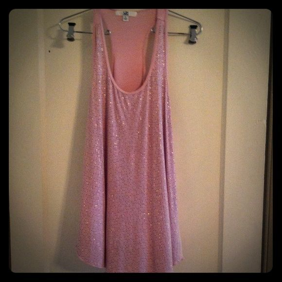 Fall Sale!Large Pink Studded Long Tank Top This is a light pink, studded, long, comfy, tank top. Pairs great with a pair of leggings. It's a size large but can fit as a loose medium. It is made by Ya - Los Angeles. Feel free to ask any questions! Ya Los Angeles Tops Tank Tops