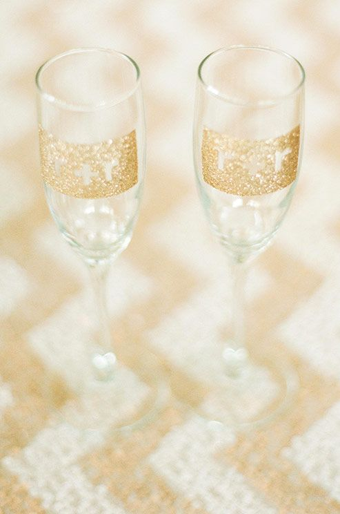 Gilded champagne flutes featuring the bride and groom's initials