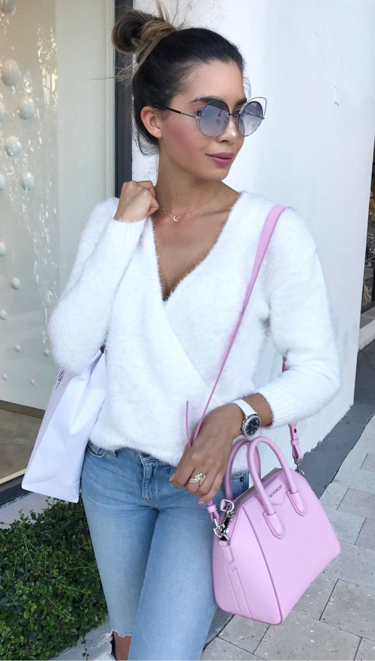 women's white v-neck long-sleeved shirt, distressed blue-washed denim pants, and pink leather 2-way tote bag