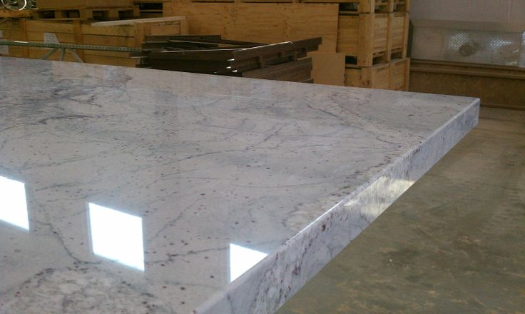 COUNTERS: River White granite with mitered edge detail.