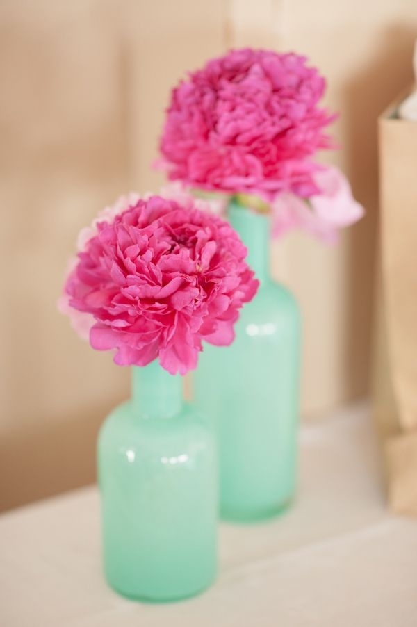 cheap and easy. mint vases with fuchsia flowers http://www.weddingchicks.com/2013/10/04/wedding-in-turquoise-and-pink/