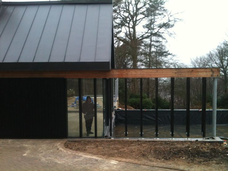 Project nearing completion at Chinnor. Glulam beams, black timber cladding, and anthracite vm zinc roof.