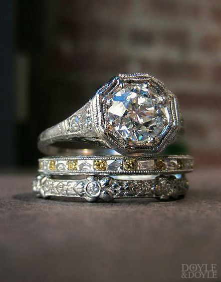What a stack, love the pop of yellow diamonds! Art Deco diamond engagement ring with contemporary diamond eternity bands, all in platinum. From Doyle