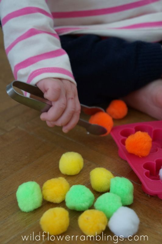 poms in a tray - 21 Activities for One Year Olds - Baby Play - Wildflower Ramblings