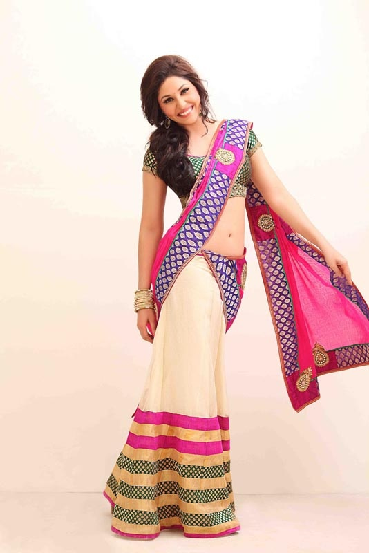 Pooja in a sexy half sari.