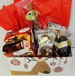 Surviving the holidays just got a lot easier with this collection of Chocolate Pizza Company favorites. Inside a festive box you will find milk chocolate Peanut Butter Wings (8 oz), Chocolate Pizza Slice (6 oz), Caramel & Nut Drumstick, Chocolate Covered Pretzel and 2 Chocolate Covered Oreos®. Packed in a festive, handled tote these make wonderful gifts for family, friends and colleagues.