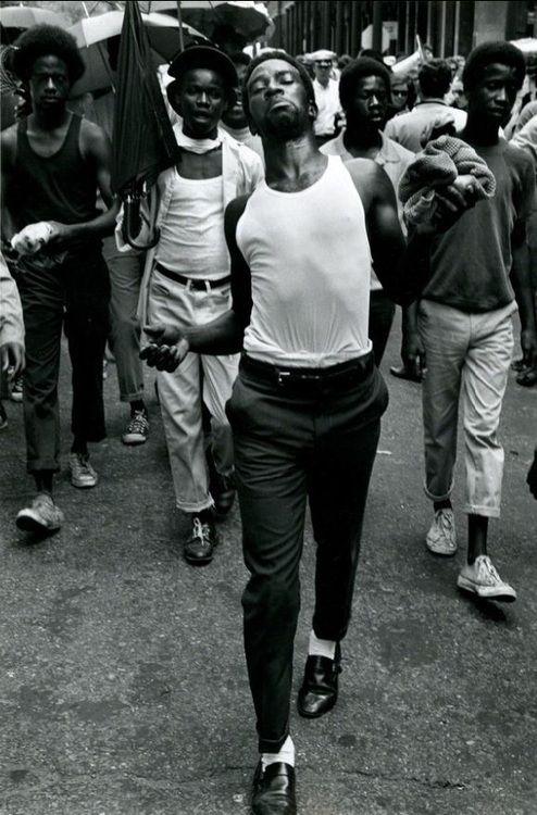ugandanmoonshine:  JAMES JOWERS N. Orleans [Man strutting down the street followed by 4 other men], 1970 Gelatin silver print My Man  My cit...