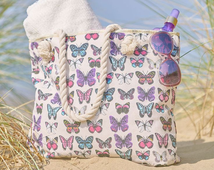 BUTTERFLY BEACH BAG  Keep all your holiday essentials in this rope handled beach bag. Fully lined and zip fastening. 100% cotton. H34 x W47 x D10cm