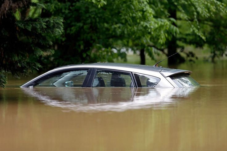 <p>A car is submerged in floodwater along Glenwood Avenue in Raleigh, N.C., Tuesday, April 25, 2017. Storms have dumped several inches of rain on North Carolina's capital, prompting firefighters to rescue people from their vehicles and delaying school bus schedules. (AP Photo/Gerry Broome) </p>
