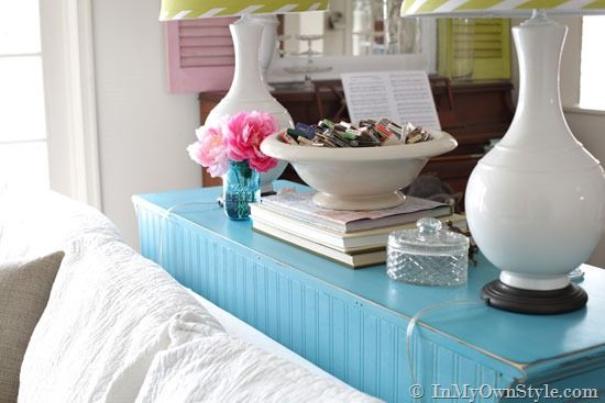 Use beadboard wallpaper to cover the back of an unfinished piece of furniture. Brilliant.