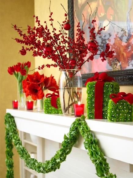 """Flower power Christmas mantel  --  wow party guests with a mantel of green flower """"presents"""" and fresh red flowers. Use pearl-top straight pins to attach green-tinted mini mums to foam squares, then tie on red velvet ribbon bows. Accent the scene with glass vases filled with red tulips, amaryllis heads and berry branches."""