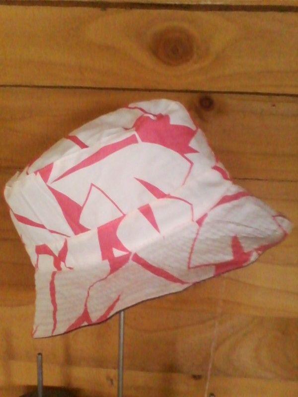 Pink and white reversible denim bucket hat