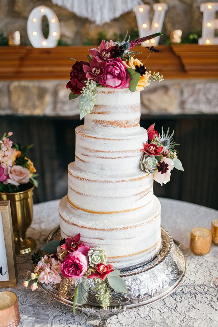 Rustic Wedding Cake with Fall Flowers and a Vintage Lace Tablecloth