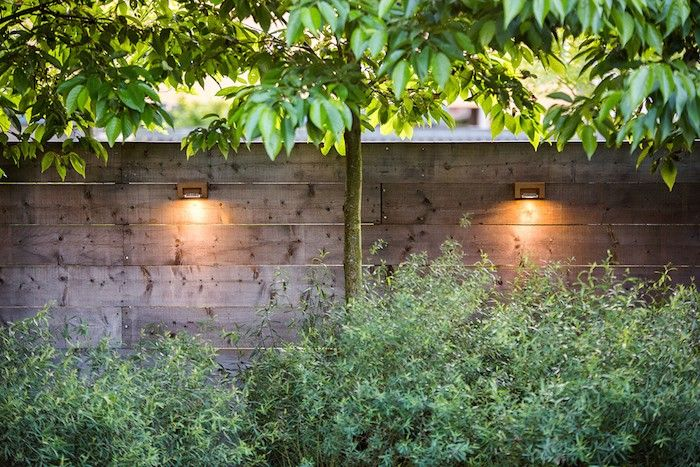 Outdoor wall lights are specifically designed and approved for wet location use; these from Royal Botania. Thoroughly informative post: Hardscaping 101: Outdoor Wall Lights by Janet Hall. via Gardenista
