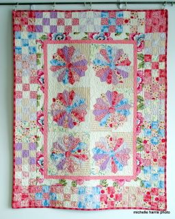 """40"""" x 51"""" this is a very pretty quilt.  It has six dresden plate blocks with borders."""