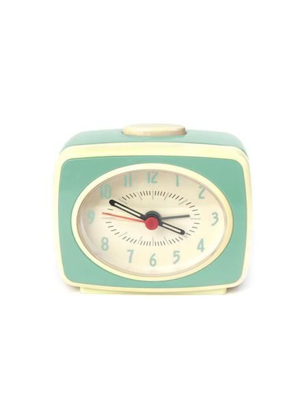"""Freshen up your night stand with this vintage inspired alarm clock. Simple, cheerful design in minty green plastic with glow in the dark hands. 3.5"""" x 3"""" x 1.75"""