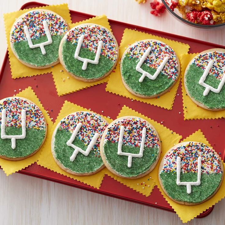 Score big with these treats for your home team as you all watch the big game! Quick and easy to make using your favorite roll out cookie dough and some colorful Wilton Sprinkles. These goal post cookies are great for youth football treats, game day snack or anytime you want a sweet and colorful treat while you cheer on your favorite team!