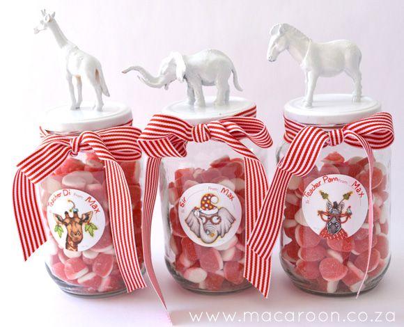 African animals, spraypainted white on jars