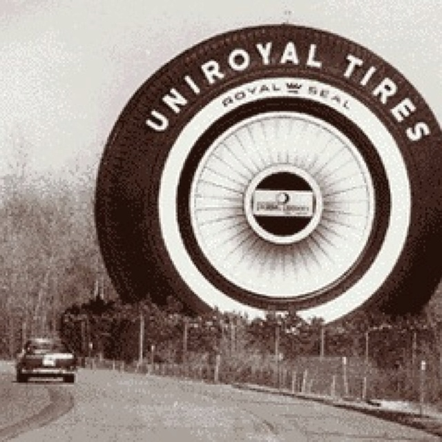 The giant tire on eastbound I-94 in Allen Park, Michigan. The only remaining symbol of the once proud Detroit tire manufacturing industry is the landmark giant tire on I-94. The gigantic tire doubled as a Ferris wheel at the 1964 World's Fair in New York. About 2 million people rode the wheel, including Jacqueline Kennedy and the Shah of Iran. After the fair, the mammoth 86-foot tire was dismantled and shipped by rail to Detroit, where it was reassembled outside a Uniroyal sal...