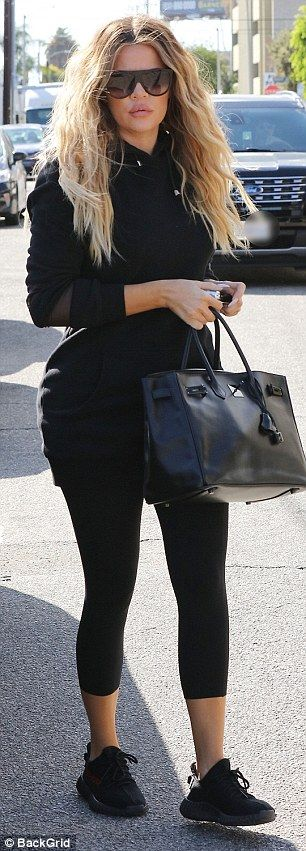 Fit goddess: Khloe, 33, chose cropped leggings with a matching black hoodie and a Hermes Birkin handbag for the Kardashian family outing