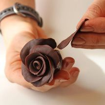 This photo tutorial will give you step-by-step instructions showing how to make chocolate roses. On this page we cover adding petals to the rose.