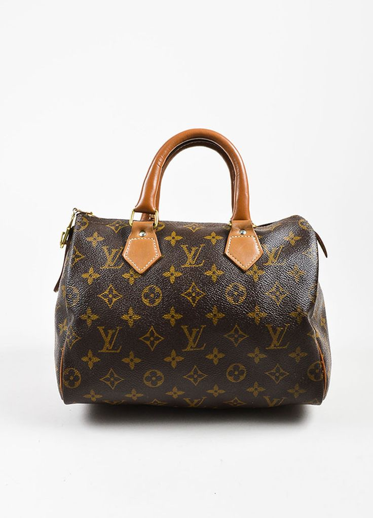 """A classic, vintage accessory for any collector or bag enthusiast. The """"Speedy 25"""" style from the Louis Vuitton The French Luggage Company collection is an iconic silhouette that is perfect for any war"""