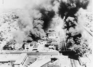The Watts Riots (or Watts Rebellion) took place in the Watts neighborhood of Los Angeles from August 11 to 17, 1965. The six-day riot resulted in 34 deaths, 1,032 injuries, 3,438 arrests, and over $40 million in property damage. It was the most severe riot in the city's history until the Los Angeles riots of 1992.