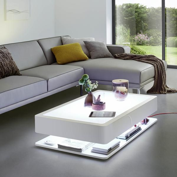 Winner of the 2015 Interior Innovation Award, Moree's Ora coffee table is a modern, illuminated design piece. White opal glass atop a hidden storage shelf provides room for books, remote controls and magazines.