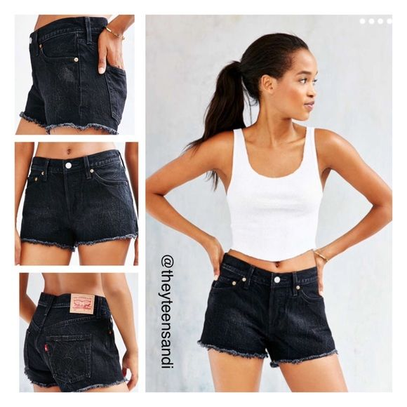 """Urban Outfitters Levi's 501 Black Jean Shorts Levi's Remote Coast Jean Short. Black wash denim shorts from Levi's in the classic 501 fit with a button-fly and button-waist closure and a classic 5-pocket design. Size sold out online.  Content + Care - 100 %Cotton - Machine wash - Imported  Size + Fit - Model is wearing a 27 - Measurements taken from size 28 - Rise: 9.5"""" - Waist: 30"""" Levi's Shorts Jean Shorts"""