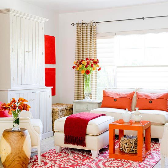 Living room orange and red accents via @Better Homes and Gardens, with our Vine Red Tufted Wool #rug!: Decor, Ideas, Orange, Living Rooms, Interiors, White Rooms, Accent Colors, Bright Colors, White Wall