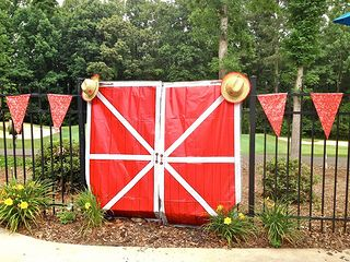 barn doors bandana pennant and cowboy hats make for great western party decorations click - Western Party Decorations