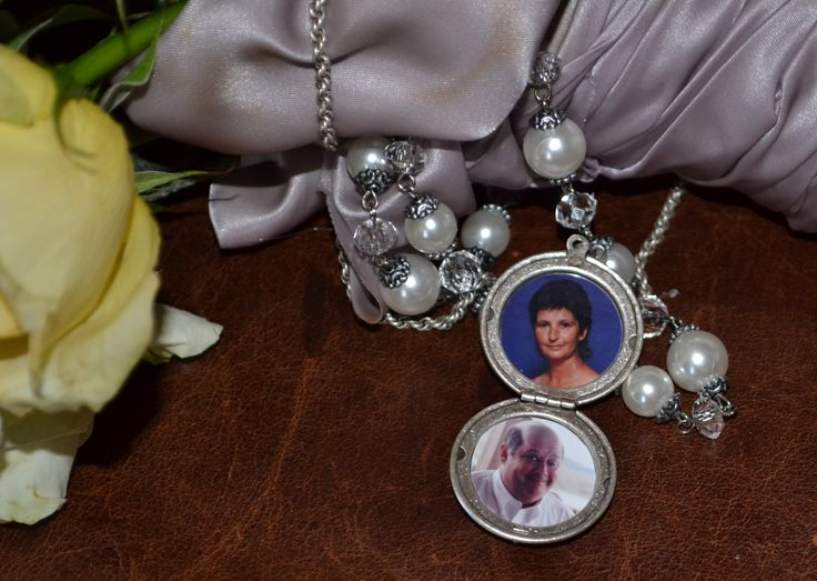 """Sherry of GA attached Heartsmith's NIghtingale locket to her bridal bouquet.  Both her father and her  husband's mother passed away a few years ago.  She included pictures of them both inside her locket as a way to remember them on her special day.  """"I am glad that I have these pictures because the locket later fell off, and we never found it.  I am still very grateful though, for the beauty and sentiment it added to my wedding day."""""""
