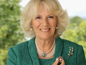 The Duchess of Cornwall with the WRVS pin to be awarded to volunteers during the Queen's Diamond Jubilee.