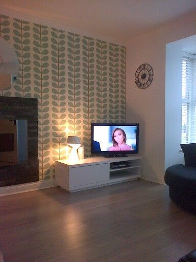 New white furniture brightens up my Orla kiely wallpaper