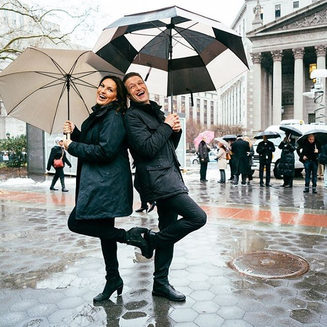 A little Sonny to ward off the rain - Mariska and Peter; umbrellas, teal coat
