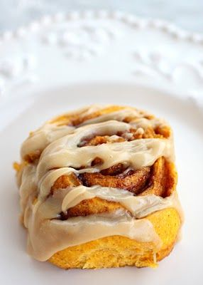 I want to make these for breakfast sometime! Pumpkin Cinnamon Rolls with Caramel Frosting | The Girl Who Ate Everything