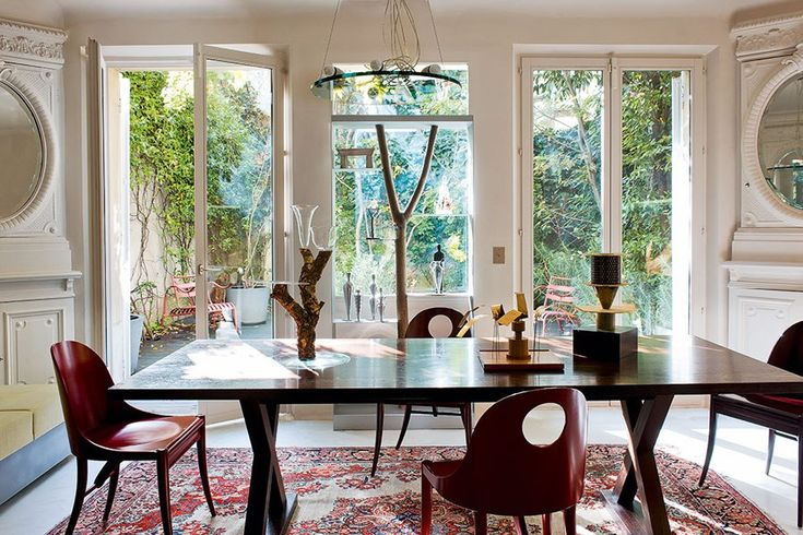 The airy dining room of interior designer Charles Zana's home overlooks an interior courtyard.