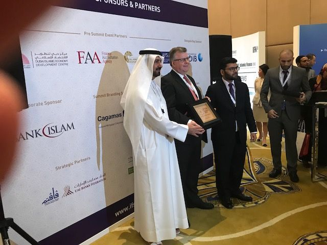 Vizor receiving a plaque from the Governor of the Central Bank of Abu Dhabi