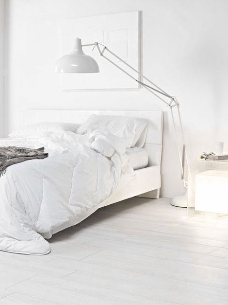 all white bedroom, large industrial floor lamp