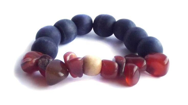 Carnelian stone with wooden navy elastic bracelet.  For price visit website.
