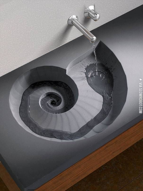 Ammonite shaped sink--wtf get in my house now! Dino themed bathroom.