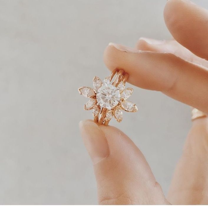 Love this concept with the engagement ring and then the wedding bands giving a vintage vibe to the ring #want
